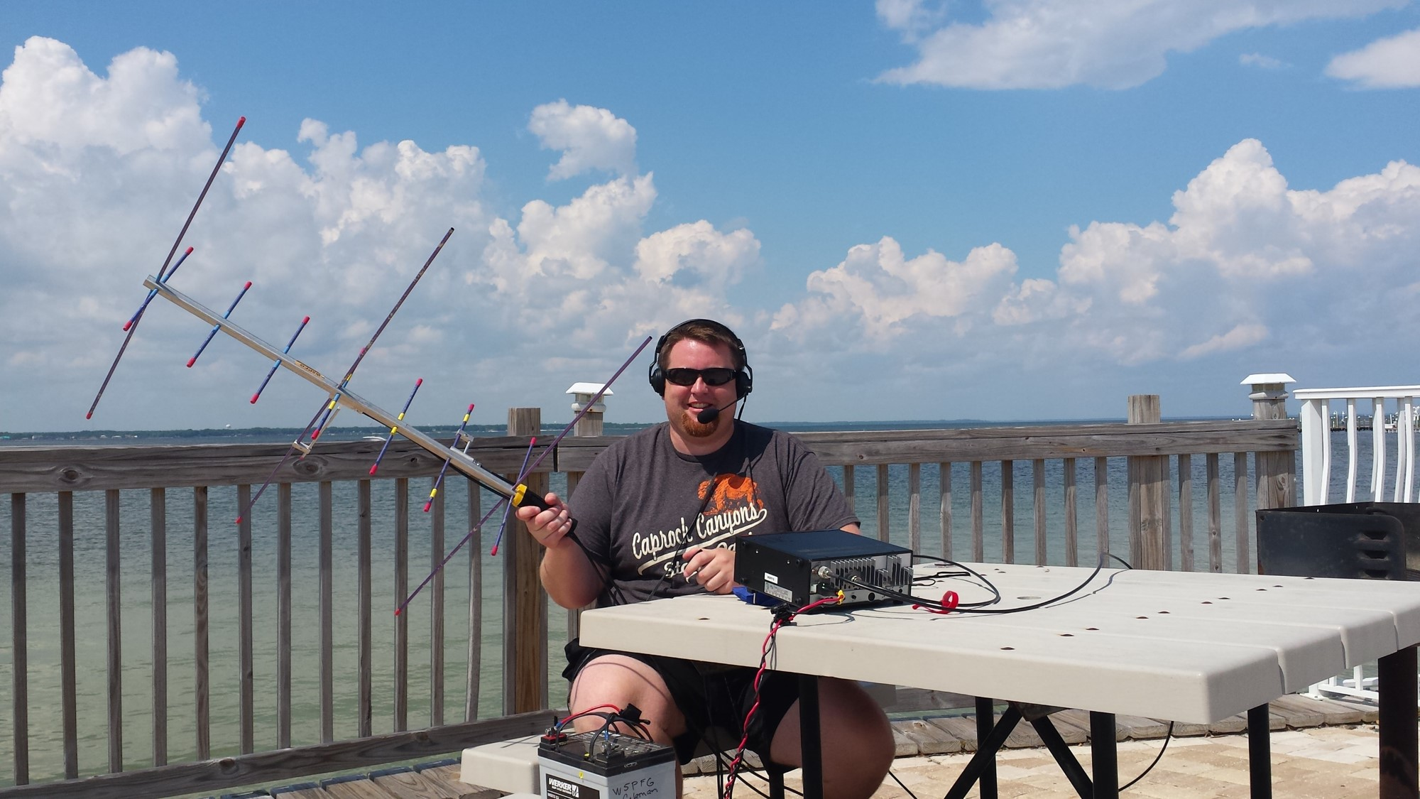 Clayton Coleman, W5PFG, shows off his portable satellite station.